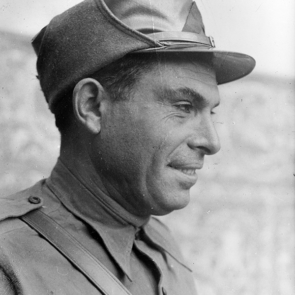 Image of Durruti as a historian discusses him with the Catalunya Barcelona team.