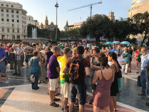 A sunny day on Plaça de Catalunya with many people gathered