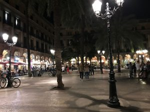 Nighttime view of one of the lampposts created by Gaudí Barcelona's Plaça Reial