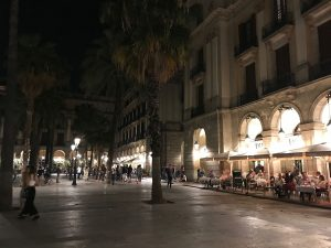 Patrons eating on the terrace of a restaurant in Barcelona's Plaça Reial