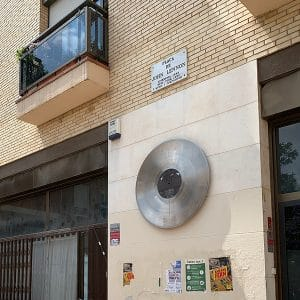 Album cover signifying that this location is Plaça de John Lennon in the Gràcia neighborhood of Barcelona.