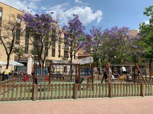 Playground with children playing Barcelona's Placa de John Lennon