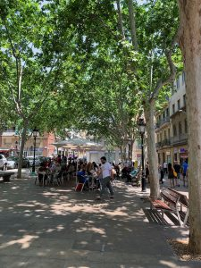 People eating and drinking on Barcelona's Plaça de Rovira i Trias.