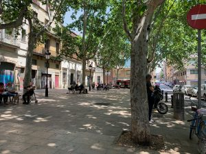 People relaxing on benches at Barcelona's Plaça de Rovira i Trias.