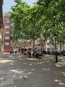 People relaxing on Barcelona's Plaça de Rovira i Trias.