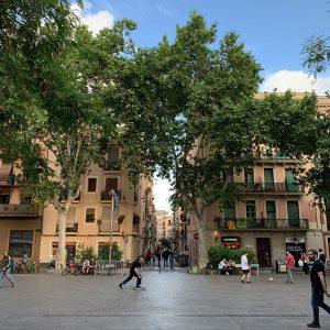 Skateboarder and soccer players on Barcelona's Plaça del Diamant