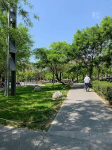 Pedestrian walking at Barcelona's Plaça Lesseps.