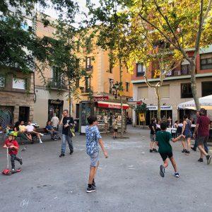 Kids playing on Barcelona's Plaça de la Vila de Gràcia