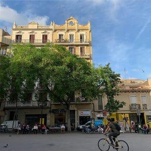 Barcelona's Plaça de la Vila de Gràcia on a sunny day.