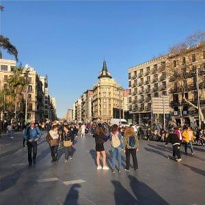 Late afternoon view of Plaça de la Universitat in Barcelona's eixample neighborhood.