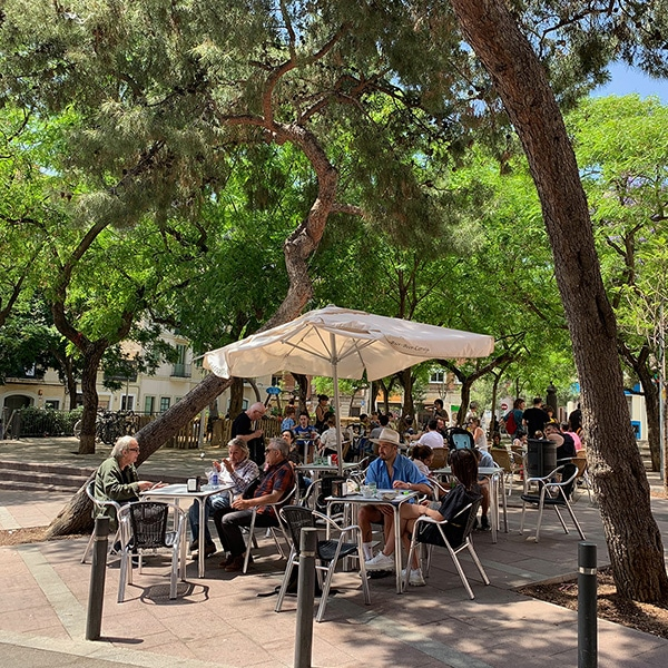People dining on Plaça del Nord Barcelona