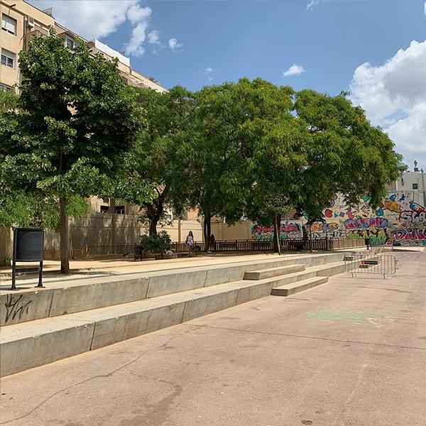 Trees and Graffiti on Plaça del Poble Romani in Barcelona