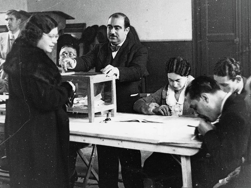 1936 - Woman voting in parliamentary elections.