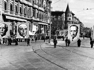1937 - Popular army parading near Plaça de Catalunya with poster of Lluís Companys.