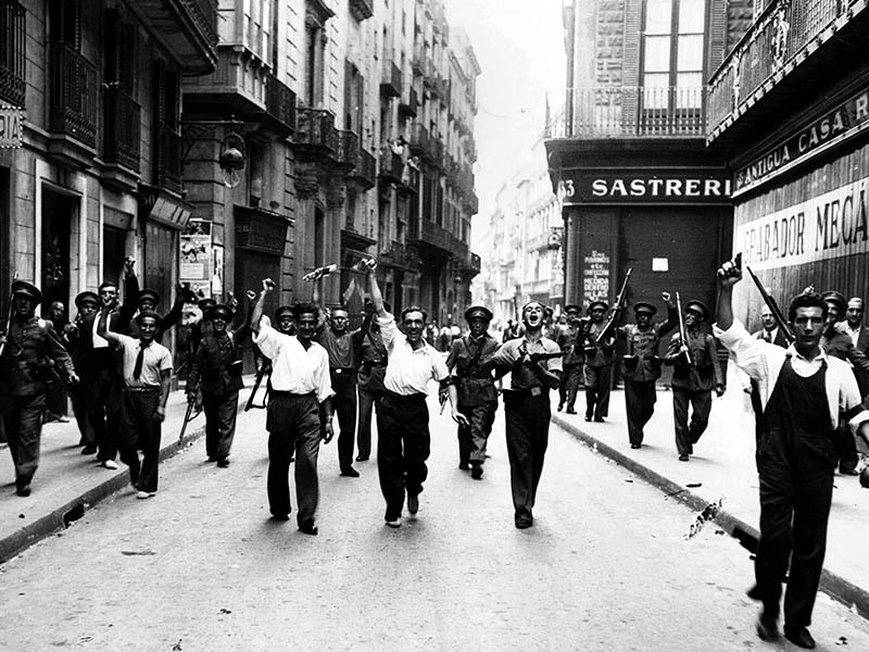 1936 - Militia members march down Carrer de Ample on July 19.