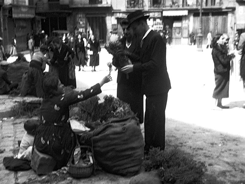 1940 - Woman in street selling thyme