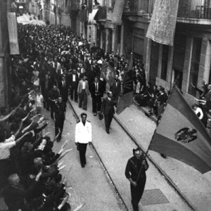 Parade of victorious rebel soldiers down the streets of barcelona after the Spanish Civil War.